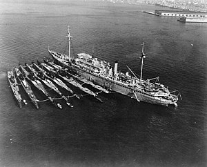 USS Holland (AS-3) with seven submarines alongside at San Diego, California (USA), on 24 December 1934 (80-G-63334).jpg