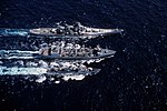USS Kansas City (AOR-3) replenishes USS New Jersey (BB-62) and USS Buchanan (DDG-14) in the Pacific Ocean on 12 August 1983 (6372764).jpeg