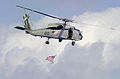 US Navy 031101-N-2385R-003 An SH-60F Seahawk assigned to the Indians of Helicopter Anti-Submarine Squadron Six (HS-6) concludes an air show demonstration by flying the American Flag during a Tiger Cruise aboard USS Nimitz (CVN.jpg
