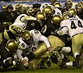 US Navy 031206-N-9693M-517 Army and Navy football players vie for control of the ball during the 104th Army Navy Game.jpg