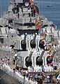 US Navy 040416-N-4154B-503 Sailors assigned to USS Theodore Roosevelt (CVN 71) Weapons Department man the rails of the Iowa-class battleship USS Wisconsin (BB 64).jpg
