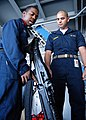 US Navy 040701-N-6293B-026 Torpedoman's Mate 3rd Class Marcus Young of Shannon, Miss., gives a safety brief on the M-60 machine gun to Midshipmen 3rd Class Zachary Weinman, of Annapolis, Md.jpg