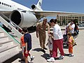 US Navy 040710-N-8861F-002 Evacuated families board their flight for home as Rear Adm. Daniel S. Mastagni, Vice Commander Navy Region Europe provides some words of encouragement to some of the children boarding the aircraft.jpg