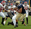 US Navy 041120-N-9693M-009 U.S. Naval Academy Midshipman 1st Class Kyle Eckel breaks through a line of Rutgers University defenders enroute to a touchdown in the 1st quarter.jpg