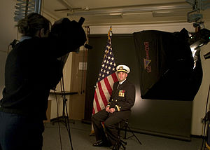 Photo shoot - Image: US Navy 050223 N 8770A 007 Photographer's Mate 2nd Class Casey R. Jones of San Angelo, Texas, prepares to photograph a studio portrait at the Photo Lab on board Naval Station Whidbey Island, Wash
