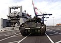 US Navy 050312-F-2902B-001 An M2A3 Bradley Fighting Vehicle is prepared for loading aboard the Military Sealift Command (MSC) roll-on-roll-off ship USNS Watson (T-AKR 310).jpg