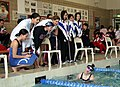 US Navy 050313-N-1113S-003 Atsugi Blue Dolphins team members and coach shout encouragement during the 400-meter Individual Medley.jpg