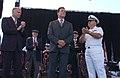 US Navy 050529-N-5621B-072 From left, San Diego Mayor Dick Murphy, California Gov. Arnold Schwarzenegger and Cmdr. Ron Ritter applaud World War II veterans.jpg
