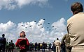 US Navy 051028-N-0413R-202 Crew members observe a flyover of Carrier Air Wing Eleven (CVW-11) aircraft in formation during an air power demonstration.jpg