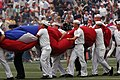 US Navy 060212-N-8157C-014 Sailors' stationed at various commands in Hawaii assist in carrying the American Football Conference (AFC) flag during the pre-game show.jpg