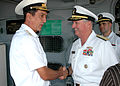US Navy 060907-N-1120L-009 Director, Strategy ^ Policy, Resources and Transformation, U.S. Naval Forces Europe, Rear Adm. Phil Greene, greets Russian Rear Adm. Sergei Menyalo, Naval District Commander.jpg