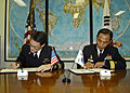 US Navy 061108-N-4649C-002 Commander, Submarine Group Seven Rear Adm. John Bird (left), and Commander, Korean Submarine Forces Rear Adm. Il Heon Bae, sign a Mutual Logistics Support Agreement.jpg