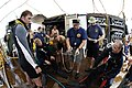 US Navy 070201-M-2067M-153 Navy divers from Mobile Diving and Salvage Unit One, Detachment Seven, Pearl Harbor, Hawaii, muster on a dive station off the coast of Aimeliik as Master Chief Navy Diver Terry White, center, briefs o.jpg