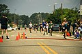 US Navy 070519-N-0193M-515 Participants sprint to the finish line during the 3rd annual Rudy Run SEAL Challenge at Naval Amphibious Base Little Creek.jpg