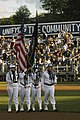 US Navy 070821-N-3390M-001 The Naval Station Everett Color Guard team marches off Everett Memorial Stadium baseball field at the conclusion of the National Anthem.jpg