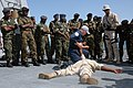 US Navy 070918-N-3255B-007 Sailors assigned to guided-missile destroyer USS Forrest Sherman (DDG 98) demonstrate how to restrain potential criminals during maritime interdiction training for Mozambiquen sailors.jpg
