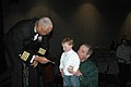 US Navy 090220-N-2257C-019 Capt. George N. Thompson, commanding officer and leader of the U.S. Navy Band, gives a young patron his first lesson in conducting after the concert band's evening performance in Oxford, Miss.jpg