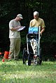 US Navy 090801-N-3312P-002 Kieth Pickles and Christopher Chilton, both from Southeastern Archeological Research Inc., use ground penetrating radar to survey burial sites discovered at Naval Weapons Station Yorktown.jpg