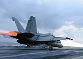 US Navy 090819-N-6567V-046 An F-A-18F Super Hornet from the Diamondbacks of Strike Fighter Squadron (VFA) 102, launches off the aircraft carrier USS George Washington.jpg