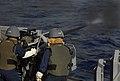 US Navy 090924-N-0807W-012 Sailors aboard the amphibious dock landing ship USS Harpers Ferry (LSD 49) fire an MK-38 25mm machine gun.jpg