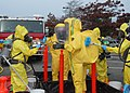 US Navy 091028-N-9860Y-005 Navy Region Northwest Fire and Emergency Services and Oak Harbor Fire Department personnel decontaminate the Navy Region Northwest Fire and Emergency Services initial entry team.jpg