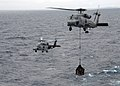 US Navy 091105-N-1644H-184 Two SH-60F Sea Hawk helicopters assigned to the Chargers of Helicopter Anti-Submarine Squadron (HS) 14 transport cargo to the aircraft carrier USS George Washington (CVN 73).jpg