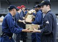 US Navy 091107-N-7478G-551 Sailors assigned to the amphibious command ship USS Blue Ridge (LCC 19) offload boxes of humanitarian supplies donated from Project Handclasp.jpg