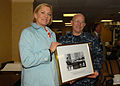 US Navy 091113-N-8560K-050 Susan Ford Bales, daughter of former President Gerald R. Ford, presents a photo to Capt. Chip Miller, commanding officer of the aircraft carrier USS George H.W. Bush (CVN 77).jpg