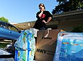 US Navy 100505-N-5862D-015 A Navy dependent looks over household items.jpg