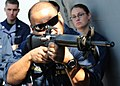 US Navy 101120-N-6499D-025 Chief Gunner's Mate Javier Villarreal demonstrates proper M-16 service rifle techniques during training aboard the guide.jpg