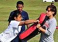 US Navy 110617-N-BK435-126 Machinery Repairman Fireman Recruit Chloe Chhuop slams her baton into Engineman 3rd Class Chrissy Rivera's bag during an.jpg