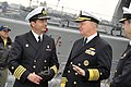 US Navy 110805-N-ZB612-151 Chief of Naval Operations (CNO) Adm. Gary Roughead speaks with Cmdr. Manuel Aguirre, commanding officer of the Chilean n.jpg