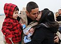 US Navy 111104-N-FJ200-047 Sailor greets his family after deployment.jpg