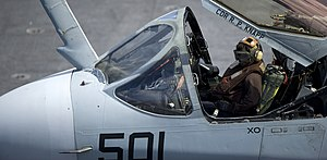 US Navy 111228-N-JN664-170 A Sailor assigned to the Lancers of Electronic Attack Squadron (VAQ) 131 performs preflight diagnostic checks inside an.jpg