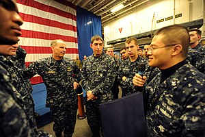 US Navy 120204-N-WL435-519 Chief of Naval Operations (CNO) Adm. Jonathan Greenert holds an all-hands call with Sailors and Marines aboard the amphi.jpg