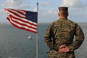 US Navy 120214-N-MJ645-014 Sailors and Marines aboard USS Bonhomme Richard (LHD-6) man the rails as the ship leaves San Diego.jpg