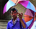 Umbrella vendor in Dhaka.jpg