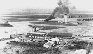Operation Frequent Wind - VNAF C-130A burns at Tan Son Nhut after rocket attack on 29 April