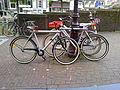 Van Moof male bikes and a female version Amsterdam.jpg