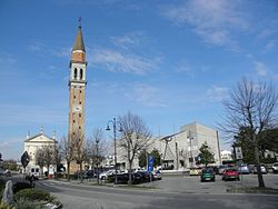 The parish church of Santa Maria Assunta and San Prosdocimo and, on the right, the town hall