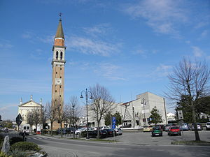 Camponogara - The parish church of Santa Maria Assunta and San Prosdocimo and, on the right, the town hall.