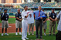 Vice Chairman of the Joint Chiefs of Staff Adm. James A. Winnefeld Jr., left foreground, receives a Cleveland Indians baseball jersey from Jim Folk, the team's vice president of ballpark operations, during 120827-N-CI293-116.jpg