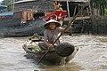 Vietnam, Phong Dien, Floating market, Vendor.jpg