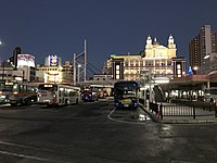View in front of Shimonoseki Station at night.jpg