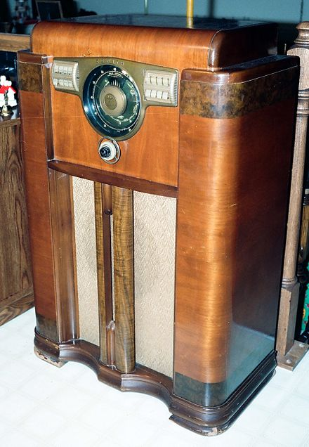 "During the ""Golden Age of Radio"" (1920 to 1950), families gathered to listen to the home radio in the evening, such as this Zenith console model 12-S-568 from 1938, a 12 tube superheterodyne with pushbutton tuning and 12 inch cone speaker. Vintage Zenith Console Radio, Model 12S-568, With the Zenith Robot (or Shutter) Dial, Circa 1941 (8655513293).jpg"