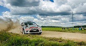 WRC Ford Fiesta going sideways in Rally Poland 2014.jpg