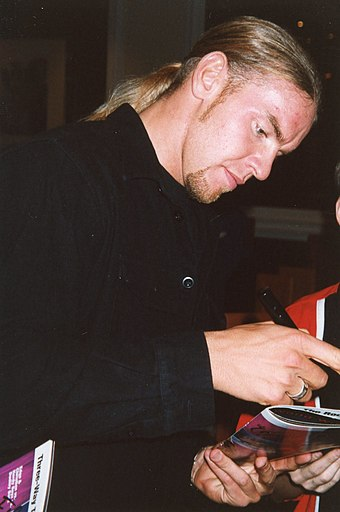 Christian signing autographs in 1999 WWE - London 6+70500 (25).jpg