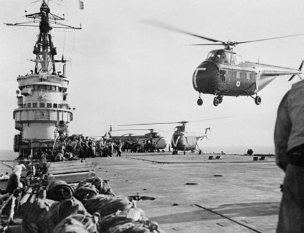 Royal Navy Westland Whirlwind helicopters taking the first men of 45 Royal Marine Commando into action at Port Said from HMS Theseus. Westland Whirlwinds taking off from HMS Theseus (R64) Suez 1956.jpg