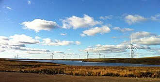 Wind power in Scotland - Whitelee Wind Farm with the Isle of Arran in the background.