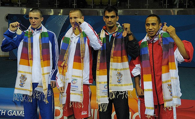 XIX_Commonwealth_Games-2010_Delhi_Winners_of_(60_kg_category_Boxing),_Thomas_Stalker_of_England_(Gold),_Josh_Taylor_of_Scotland_(Silver)_and_Jai_Bhagwan_of_India_(Bronze)_Lornalito_Moala_of_Tonga_(Bronze).jpg